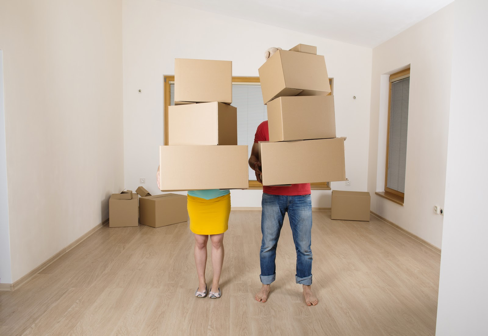 Young couple is moving into new house with lot of boxes